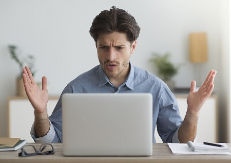 Image of Man disappointed at computing experience