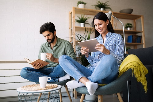 image of couple reading book and ebook